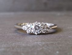 Skinny Thin Trilogy Diamond Engagement Ring, Knife Edge Diamond Ring, Classic Elegant Engagement Ring by ArahJames on Etsy https://www.etsy.com/listing/246074002/skinny-thin-trilogy-diamond-engagement