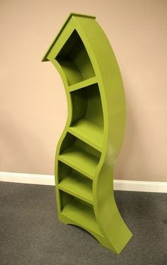 What a great bookshelf for a Dr. Suess bedroom. This link is where you can buy this shelf, but I'm just going to use this picture and make my own. I think I'm going to make my shelves straight though otherwise it will drive me crazy.