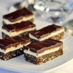 ROCK RECIPES - These delectable, no-bake Chocolate Mint Nanaimo Bars are a twist on a classic Canadian treat that originated in its namesake town in British Columbia. Nanaimo Bars, No Bake Cookies, Cake Cookies, Köstliche Desserts, Delicious Desserts, Baking Recipes, Cookie Recipes, Easy Recipes, Romanian Desserts