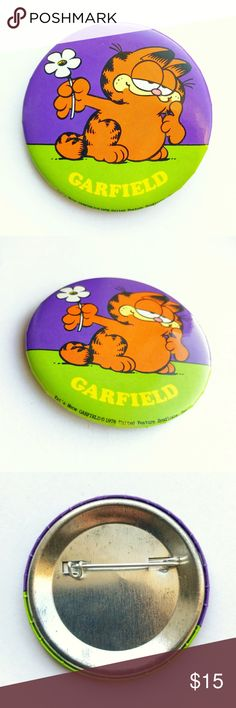"""'78 Garfield Pin '78 Garfield Pin  • true vintage • 2  1/4"""" • yellow, orange, white, black, purple • tags: 70s seventies flower kat's meow animated movie tv show film funny sarcastic collectible memorabilia nostalgia classic cartoon animation button badge pinback brooch hat jacket vest lapel bag backpack accessory • all of the pins I sell are vintage & may contain minor nicks, imperfections, or oxidation Vintage Accessories"""