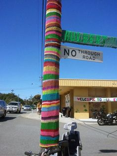 street sign; yarn bombing
