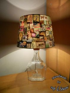 Vintage postage stamps collage on a used whiskey bottle transformed to a unique lampshade Diy Arts And Crafts, Home Crafts, Paper Crafts, Old Stamps, Vintage Stamps, Decorate Lampshade, Lampshades, Postage Stamp Art, Displaying Collections