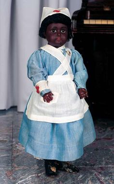 "Marks: E made in Germany 9. Comments: Kestner,circa 1900. Value Points: the doll wears her original blue chambray nursing dress with white apron and cap bearing Red Cross emblem,along with Red Cross button ""I Serve"",original handmade undergarments,stockings,shoes"