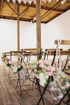 {Flower accents on wooden chairs.}