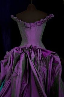 back view of corseted wedding dress in shot silk (1st of two pins)