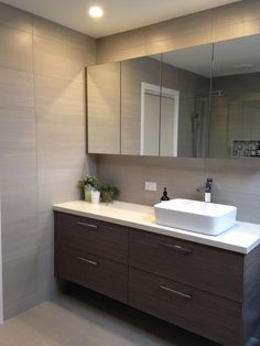 Beautiful under cabinet bathroom lighting created by using warm similar ideas mozeypictures Image collections