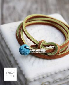 Love this! Leather Diffuser Wrap Bracelet OR Lariat necklace with Turquoise Lava Bead. Loving this for a beachy look.