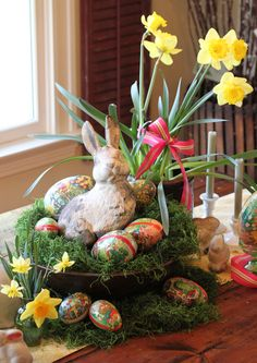 "Julia gets mileage out of her favorite collectibles, such as this vintage cast plaster rabbit, by mixing them up each season with new accessories. This Easter, the bunny appears fresh in an ""Easter basket"" made from an old wooden bowl filled with German papier-mâché eggs."