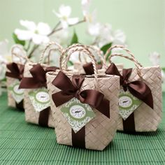 Mini Palm Leaf Favor Bags  These are really cute