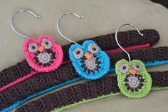 Crocheted covered coat hangers with crocheted owl motifs