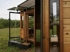 Huckberry | Shelter: Writer's Cabin. Love the rain water going into a trough (for reuse? I would).