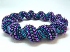 Deepening Twilight Cellini Spiral Beadwoven Bangle Bracelet - The Twisted Collection. $49.00, via Etsy.