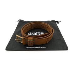 This sturdy, perforated heavy belt improves with the passing of time, while the double hole makes it much easier to change the buckle's position.   Product details - Colors: Black, Brown, Camel & Natural - Strong & Thick - One piece of leather - Best quality leather - Handmade - Closure with 2 hooks  - Double brass roller buckle  - Brass metal logo  - Painted edge - Belt sizes with buckle - Wide 3.7 cm - Thickness 0.3/0.5 cm - S-100cm M-110cm  - L-120cm XL-130cm