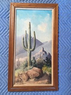 GT PICKETT (AMERICAN, 20TH CENTURY) SIGNED ORIGINAL OIL ON BOARD OF A SAGUARO CACTUS DESERT LANDSCAPE. SET IN AN OAK FRAME WITH LINEN MATTING, MEASURES 16W X 28L. PICKETT PIECES DON'T COME UP OFTEN SO DON'T MISS OUT ON THIS BEAUTY.