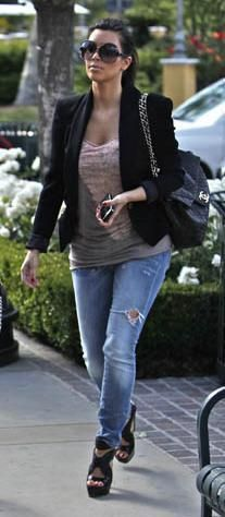 Who made Kim Kardashian's black platform sandals, black sunglasses, jeans, tie dye tank top, and black purse that she wore in Hollywood on May 9, 2010? Purse – Chanel  Shoes – Proenza Schouler  Shirt – Raquel Allegra  Jeans – R13  Sunglasses – Balenciaga