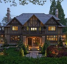 Hooked on Houses I'd call this mock-Tudor rather than Colonial Revival...