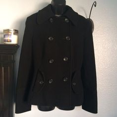 """Express Cashmere Blend Black Peacoat Firm PriceNew Condition Express Cashmere Blend Black Peacoat 8 front button, button on each pocket. With a 2 button back waist accentuation strap. Sleeves have 3 buttons on each cuff. No buttons missing. Measurements armpit to armpit 19 1/2"""". Length 25"""". No damage, snags or furballs. Maybe worn once? Forgot I had it since I have 2 other favorites. Express Jackets & Coats"""