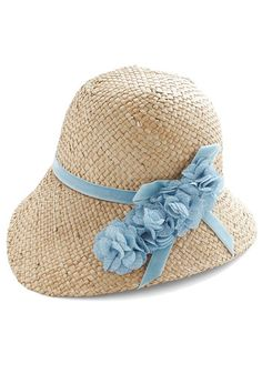 Pure Edith Hat in Blue from Modcloth ... with a little alteration to the trim it could steampunk up nicely since to me looks like an homage to a pith helmet but more appropriate for afternoon ladies wear.