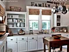 Love the open shelves.  You can create a functional and beautiful kitchen without spending lots of $ Update your hardware, paint the inside of your wall cabinets and add some pleasing decor.