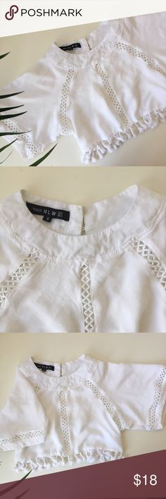 """NLW white crop top / cover up Excellent condition super cute crop too or bikini cover up with tassels and cut sleeves and on the back. Pit to pit: 16"""" length:13,5"""" NLW Tops Crop Tops"""