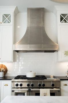 Plain subway tile with white grout disappears.Best kitchen backsplash tile Backsplash is a classic - and affordable -white subway tile Timeless tile subway tile source on Home Bunch Best Tiles For Kitchen, Kitchen Tiles, Cool Kitchens, Kitchen Board, Kitchen Hoods, White Kitchens, Kitchen Island, Kitchen Cabinets, Country Kitchen Designs