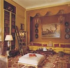 Duke & Duchess of Windsor's Paris home ~ A long banquette covered in golden-yellow brocade takes up an entire wall of the library and the equestrian painting is a portrait of the Duke of Windsor .