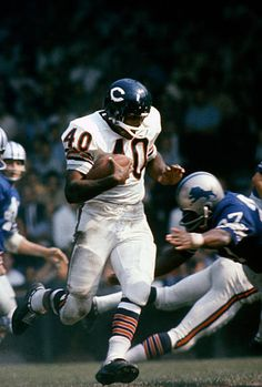 Gale Sayers of the Chicago Bears carries the ball against the Detroit Lions during an NFL football game circa 1965 at Tiger Stadium in Detroit, Michigan. Sayers played for the Bears from Get premium, high resolution news photos at Getty Images Detroit Lions Football, Nfl Football Games, Bears Football, Detroit Michigan, School Football, Nfl Bears, Football Memes, Detroit Tigers, College Basketball