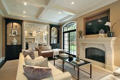 Love the limestone fireplace surround and black built ins