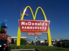 """SOCIAL PROOF /// McDonald's """"Drive-Thru"""" displayed their number of customers served in millions, and later followed by the billions. Some signs simply stated """"billions and billions served"""". Would you buy a burger from a fast food chain that has served billions of customers? Of course you would!"""