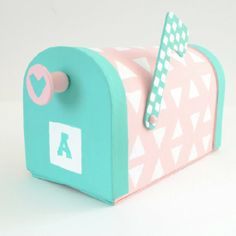 This super sweet, geometric mailbox makes a great Valentine card box for student or teacher!