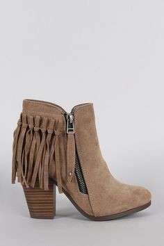 These western inspired cowgirl fringe design at the back, round toe silhouette, and chunky stacked heel. Finished with cushioned insole, soft interior lining, and side zipper closure for easy on/off.