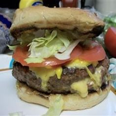 Stuffed Burgers - Big juicy burgers filled with chilies, cheese and mushrooms, then grilled and basted with steak sauce