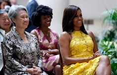 """Ho Ching, left, wife of Singapore's Prime Minister Lee Hsien Loong, and first lady Michelle Obama, watch a performance at the National Gallery of Art in Washington, Tuesday, Aug. 2, 2016. The first lady and Ho Ching toured the National Gallery of Art, West Wing and watched a performance by a group with the """"Turnaround: Arts"""" program. Photo: Alex Brandon, AP / Copyright 2016 The Associated Press. All rights reserved. This material may not be published, broadcast, rewritten or redistribu"""