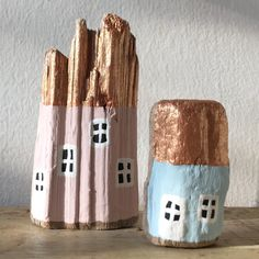 Hand painted houses on driftwood. This group is made up of two houses standing on their ownHeight: pink house 11cm, blue 6.5cm. Both houses have copper painted roofsPlease contact me for other colors/sizes available at ELOEIL.shop@gmail.comPrice includes worldwide shipping from Israel.  All wood houses are hand painted on driftwood pieces collected by the Mediterranean Sea or in Scandinavia. Each is unique and painted according to its shape, texture and tone....
