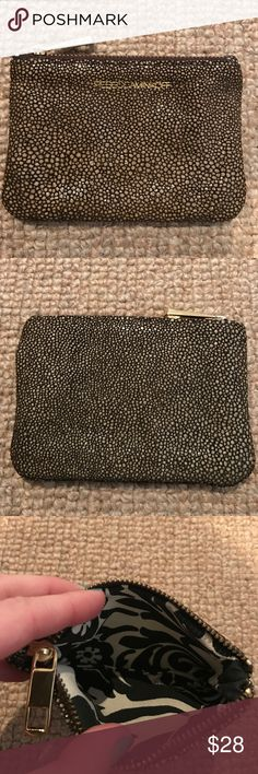 [Rebecca Minkoff] stingray pouch Stingray embossed leather pouch.  Gold logo on front and gold hardware.  Black and white paisley print/floral lining.  Perfect as a wallet! Rebecca Minkoff Bags Wallets