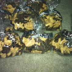Perfect party favors for jungle themed baby showers/birthday parties! Animal crackers with animal print ribbons.