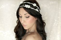 So sweet Wedding Crown, pretty white dogwood  ... set on a had painted pearl wire vine base,  Open back ties with a soft shimmering ribbon for the perfect fit.    I also have this crown in ivory and blue as well .... and can make it on a natural brown wire vine base instead of pearl .. convo me for ...    $50