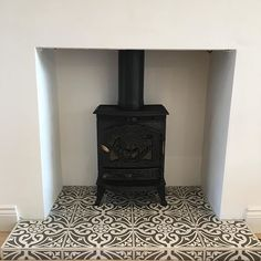 Log burner now back in place #logburner #fireplace #featuretiles #tiles #houserenovation #houseremodel #houseextension #myhome #myhomevibe #interior