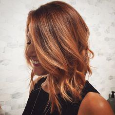 Rose gold hair, long bob haircut with texture and beach waves