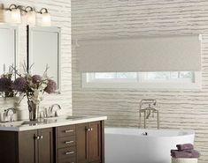 When choosing bathroom window treatments, style can be a big factor, but also make sure you select a material that will hold up against high humidity. Bathroom Window Treatments, Bathroom Windows, Blackout Shades, Solar Shades, Shades Blinds, Natural Texture, Home, Natural Materials, Raising