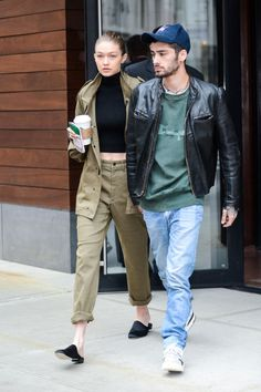 Gigi Hadid wore a cropped high neck top and a neutral two piece set while leaving her New York City apartment with boyfriend Zayn Malik.