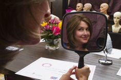 More than a makeover: Event helps lift spirits of cancer patients  A cancer patient checks out her makeover during a Look Good ... Feel Better event. The program of the American Cancer Society provides makeup kits and consultations with cosmetologists trained in the art of beautifying women undergoing cancer...