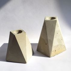 "Inspired by the modern landscape and materials of New York City, this geometric and faceted candlestick holder is hand-cast. Dimensions: Measures 2.5"" x 2.5"" x 4"". Details: Concrete. Due to the handma"