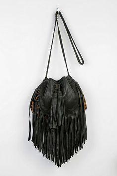 Cleobella fringe bucket bag, handmade in Bali by local artisans. #urbanoutfitters