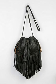 Cleobella fringe bucket bag, handmade in Bali by local artisans. #urbanoutfitters