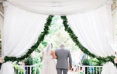 Don't just rely on draping for a romantic look at your Nashville wedding.  Add greenery like this gorgeous garland from Nashville wedding florist, Enchanted Florist. Click the image to learn more about this Nashville wedding florist. Photo credit: Jen & Chris Creed Photography