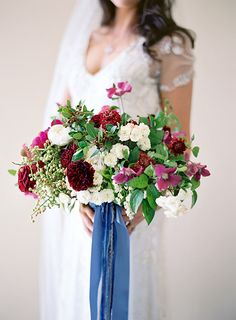 Berry tone bouquet with blue ribbon | Berries & Blues Wedding Inspiration Board | SouthBound Bride | http://www.southboundbride.com/inspiration-board-berries-blues | Credit: Jose Villa/Stacy Mccain Event Planning/Flowerwild