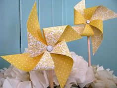 How to make a pinwheel.  Good thing I picked up all those grommets at a garage sale last year!