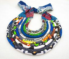 This beautiful multicolored statement necklace is made by hand with african wax prints and has an added pop of blue to elevate it to the next