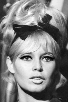 """Brigitte Bardot wears one of her famous """"choucroute"""" hair styles with an adorable bow. For all things Classic Hollywood, visit… in 2020 Brigitte Bardot, Bridgette Bardot Style, Bridget Bardot Hair, Jacques Charrier, Animal Activist, Old Movie Stars, Celebrity Travel, Celebrity Couples, Celebrity News"""